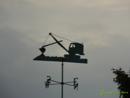 weather-vane-next-to-lake